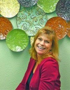 Julie DeHarty Crawford Broadcasting KLVZ